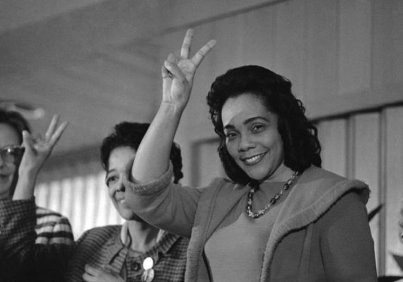 Coroetta Scott King, Wife of late Dr. Martin Luther King signals for victory over racial prejudice at conclusion of her address to Woman Power in Action for Peace Conference at Wisconsin University, Milwaukee Nov. 22, 1969. She said women should be involved in the fight against poverty, racism and war. (AP Photo)